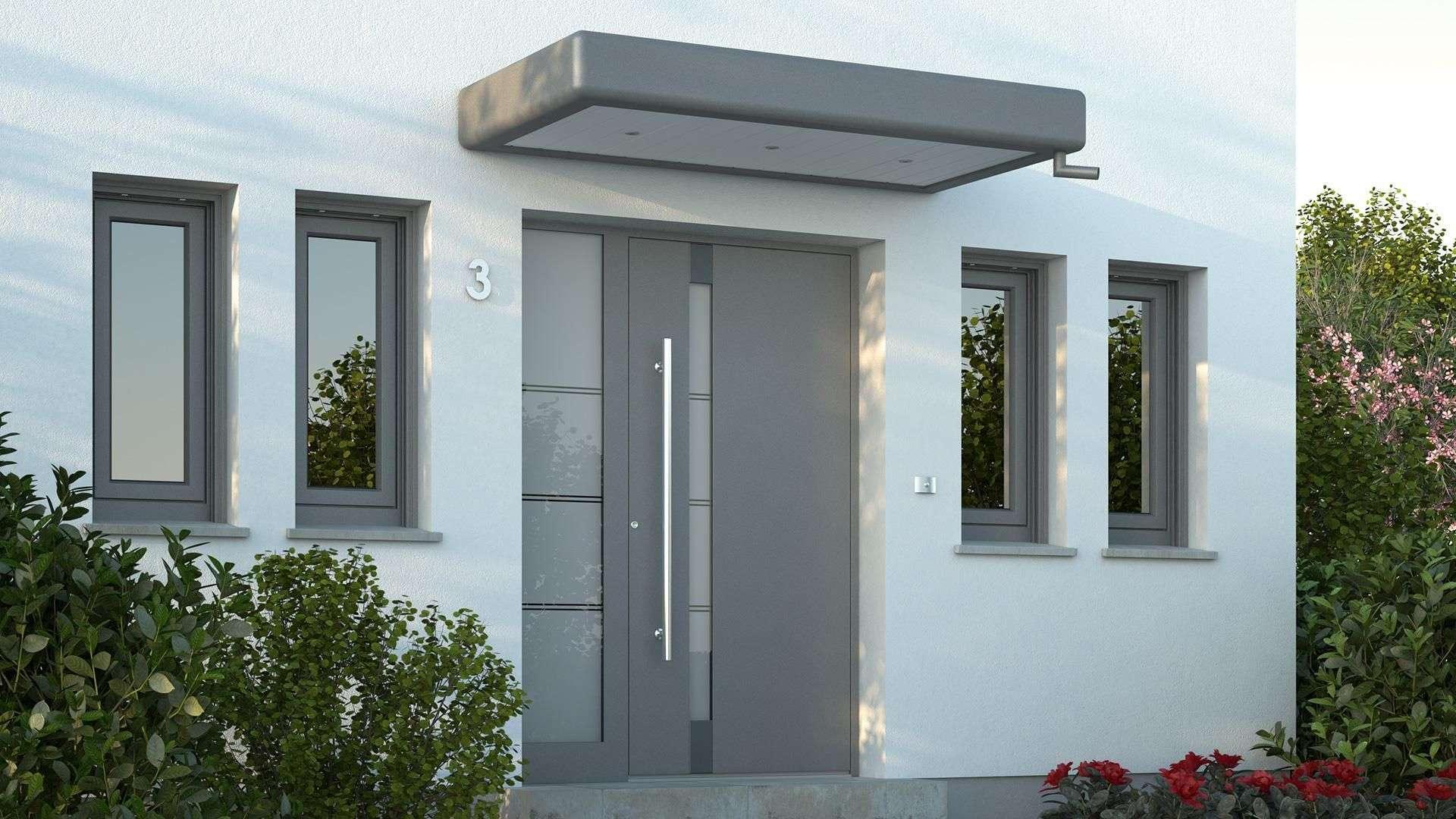 Eine graue Haustür in modernem Design.