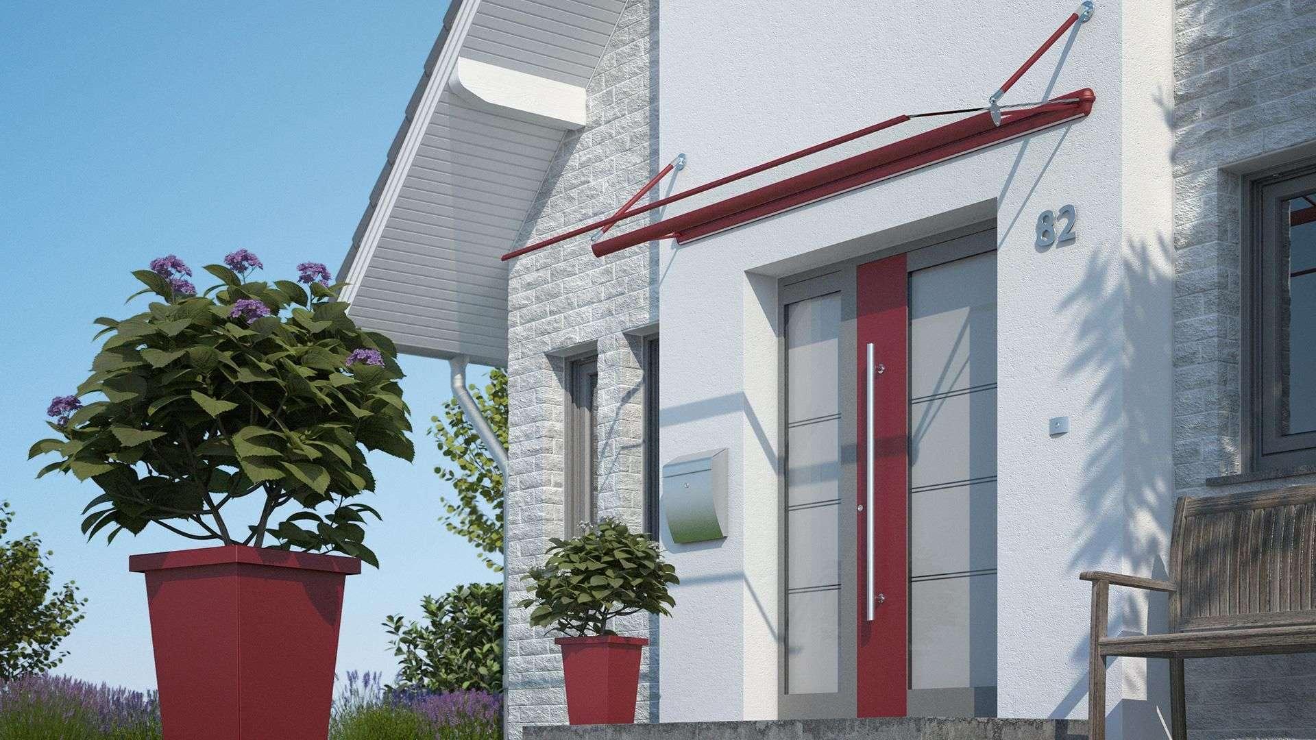 Eine Haustür mit roten Akzenten