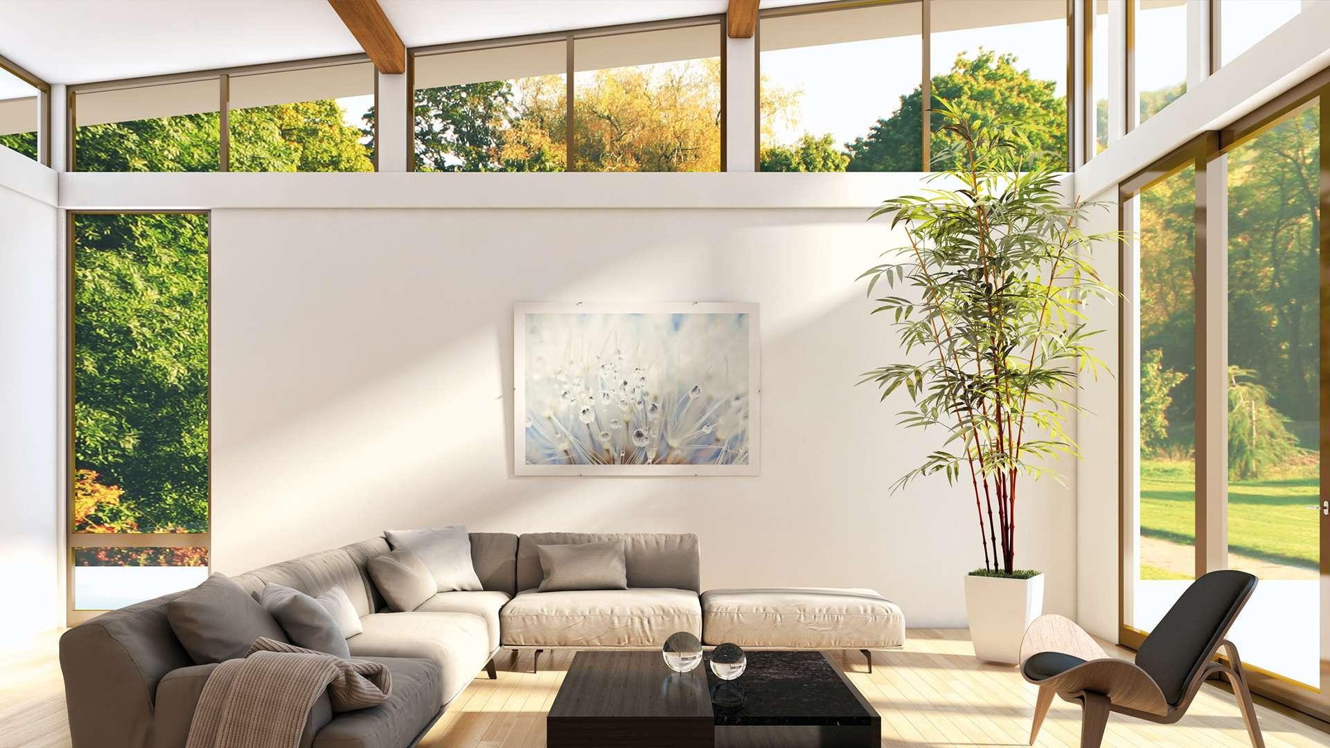 Wohnzimmer mit Gayko-Fenster zur Terrasse und unter der Dachschräge
