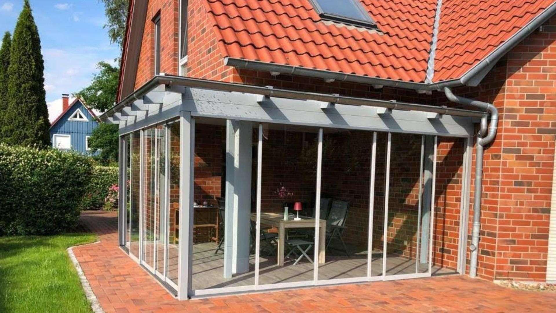 Glashaus an einem Einfamilienhaus