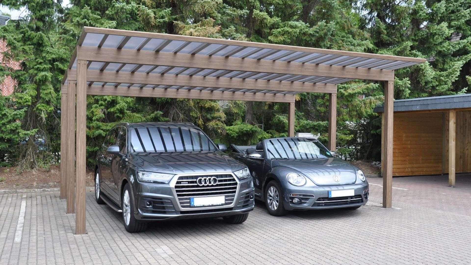 zwei Autos unter einem Carport Artport