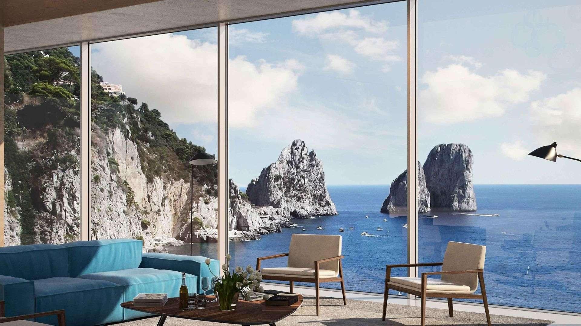 Fensterfront mit Blick aufs Meer mit Steilküste