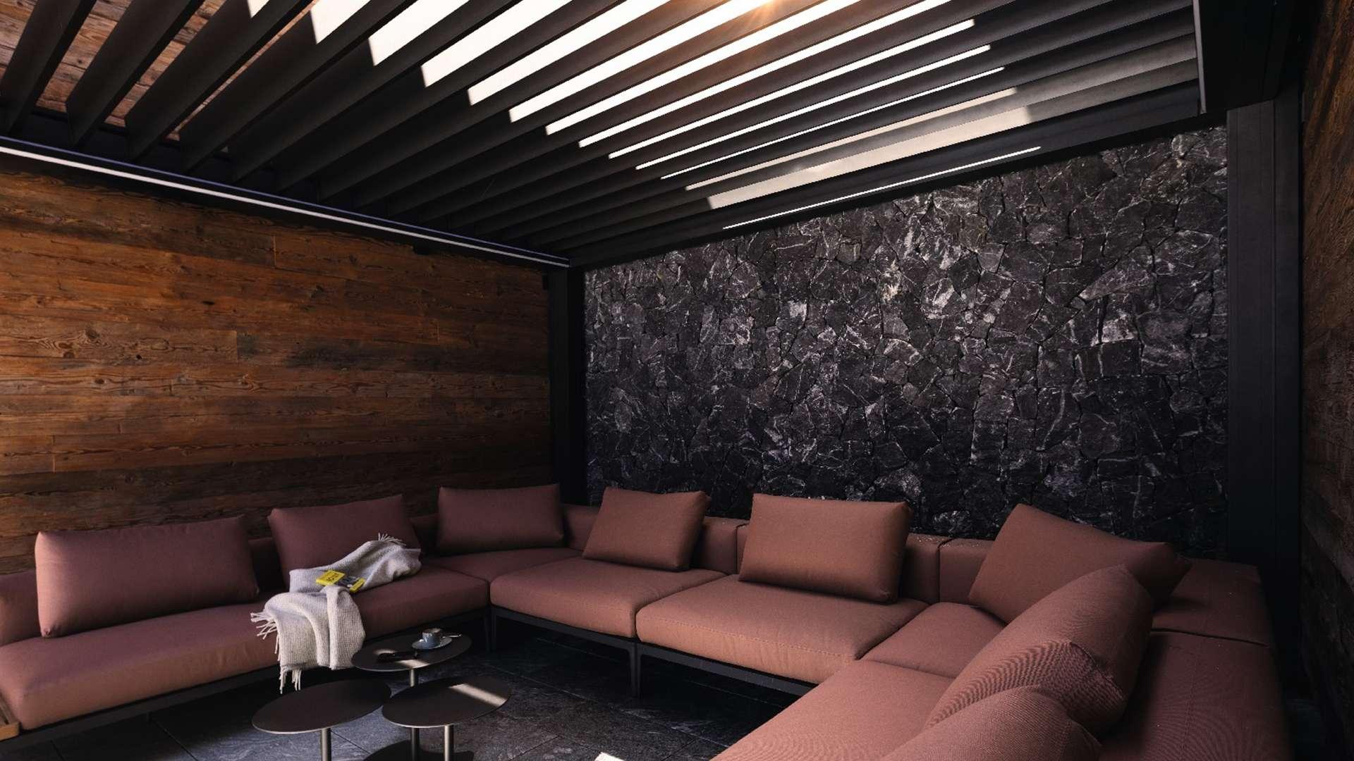Innensicht eines Lamellendaches mit großem rotem Sofa