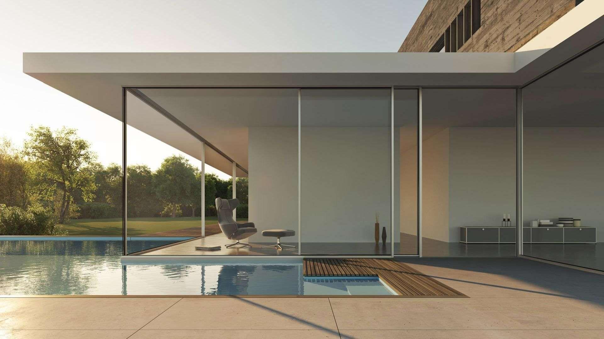 geöffnetes cero Schiebefenster vor einen großen Pool